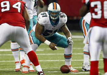 Dolphins-center-mike-pouncey-prepares-to-snap-ball-against-falcons_display_image