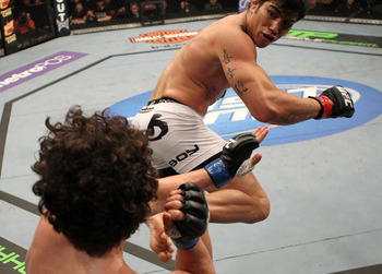 Erick Silva throws spinning kick against an overmatched Charlie Brenneman (Photo by Josh Hedges/Zuffa LLC/Getty Images)