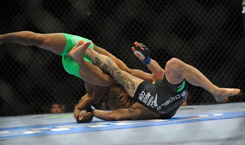 Demetrious Johnson pulls of a solid victory (Photos via US Presswire)