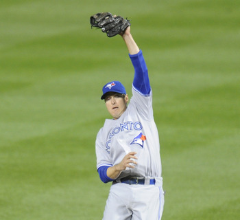 Kelly Johnson leaps to make a catch in Toronto's game against Baltimore on April 25.