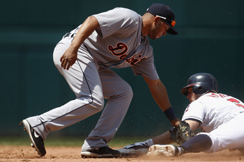 Jhonny Peralta tries to tag out a runner trying to steal a base.