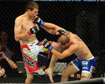 June 8, 2012; Sunrise, FL, USA; Tim Means (left) kicks Justin Salas during their UFC bout at BankAtlantic Center. Mandatory Credit: Steve Mitchell-US PRESSWIRE