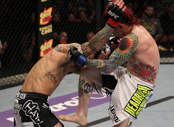 SUNRISE, FL - JUNE 08: (R-L) Scott Jorgensen lands a knee against Eddie Wineland in a bantamweight bout during the UFC on FX 3 event at Bank Atlantic Center on June 8, 2012 in Sunrise, Florida. (Photo by Josh Hedges/Zuffa LLC/Zuffa LLC via Getty Images)
