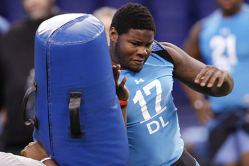 INDIANAPOLIS, IN - FEBRUARY 27: Defensive lineman Justin Francis of Rutgers participates in a drill during the 2012 NFL Combine at Lucas Oil Stadium on February 27, 2012 in Indianapolis, Indiana. (Photo by Joe Robbins/Getty Images)