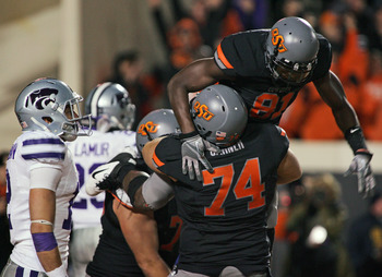 STILLWATER, OK - NOVEMBER 5:  Wide receiver Justin Blackmon #81 and offensive lineman Grant Garner #74 of the Oklahoma State Cowboys celebrate a touchdown in the second half against the Kansas State Wildcats on November 5, 2011 at Boone Pickens Stadium in