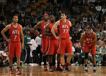 BOSTON, MA - MAY 06:  Jannero Pargo #7, Ivan Johnson #44, Erick Dampier #25, Vladimir Radmanovic #77, and Willie Green #33 of the Atlanta Hawks head onto the court after a timeout in the second half during a game with Boston Celtics in Game Four of the Ea