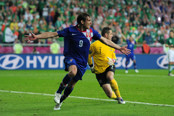 Nikica Jelavic wheels away after breaking Irish hearts