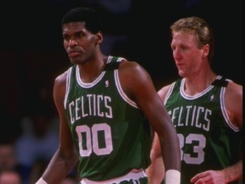 Photo Source: http://dberri.files.wordpress.com/2011/08/robert-parish-larry-bird.png