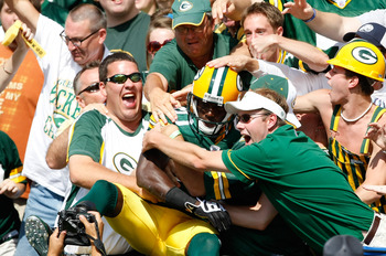 GREEN BAY, WI - SEPTEMBER 20: Wide receiver Donald Driver #80 of the Green Bay Packers jumps in the stands with fans as he does the Lambeau Leap after a touchdown in the 1st quarter against the Cincinnati Bengals at Lambeau Field on September 20, 2009 in
