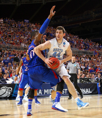 Tyler Zeller tries to get in position for a basket during UNC's Elite 8 loss to Kansas.