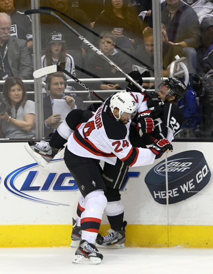 LOS ANGELES, CA - JUNE 06:  Bryce Salvador #24 of the New Jersey Devils checks Trevor Lewis #22 of the Los Angeles Kings in Game Four of the 2012 Stanley Cup Final at Staples Center on June 6, 2012 in Los Angeles, California.  (Photo by Bruce Bennett/Gett