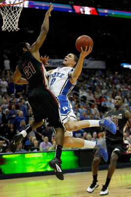 ATLANTA, GA - MARCH 10:  Austin Rivers #0 of the Duke Blue Devils goes up against Michael Snaer #21 of the Florida State Seminoles in the second half during the semifinals of the 2012 ACC Men's Basketball Conferene Tournament at Philips Arena on March 10,