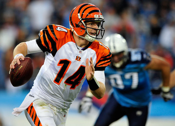 NASHVILLE, TN - NOVEMBER 06:  Andy Dalton #14 of the Cincinnati Bengals rolls out under pressure from Karl Klug #97 of the Tennessee Titans during play at LP Field on November 6, 2011 in Nashville, Tennessee. The Bengals won 24-17.  (Photo by Grant Halver
