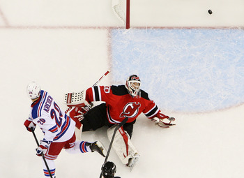 NEWARK, NJ - MAY 19:  Chris Kreider #20 of the New York Rangers scores a third period goal past Martin Brodeur #30 of the New Jersey Devils in Game Three of the Eastern Conference Final during the 2012 NHL Stanley Cup Playoffs at the Prudential Center on