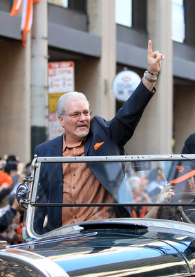 Giants' GM Brian Sabean waves to the crowd at the victory parade