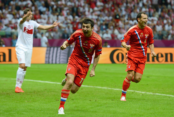 Dzagoev celebrates his opening goal against Poland earlier today