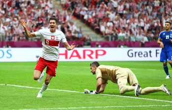 Lewandowski wheels away after opening the scoring against Greece