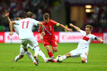 Andrey Arshavin goes past three Polish defenders