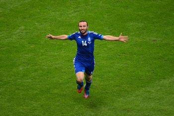 Salpingidis celebrates his goal against Poland