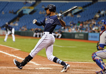 ST. PETERSBURG, FL - MAY 23:  Outfielder B. J. Upton #2 of the Tampa Bay Rays doubles in the 11th inning to drive in the game-winning run against the Toronto Blue Jays May 23, 2012  at Tropicana Field in St. Petersburg, Florida.  (Photo by Al Messerschmid