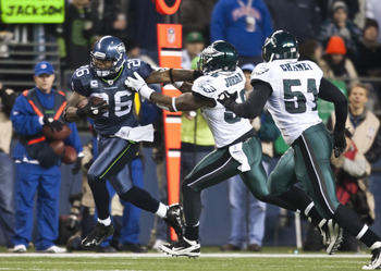 SEATTLE, WA - DECEMBER 1:  Michael Robinson #26 of the Seattle Seahawks runs past Akeem Jordan #56 and Jamar Chaney #51 of the Philadelphia Eagles  at CenturyLink Field December 1, 2011 in Seattle, Washington. Seattle won 31-14. (Photo by Jay Drowns/Getty