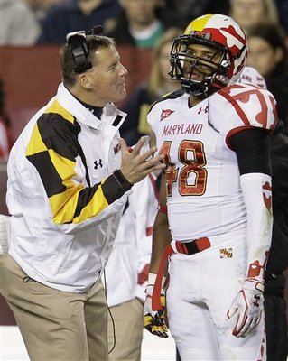 Coach Edsall speaks to Eric Franklin on the sidelines in 2011.