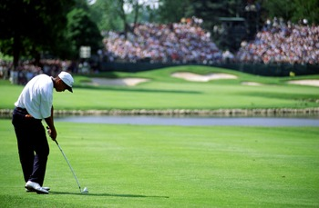 13 Jun 1996:  Ameteur Tiger Woods hits his second shot on the 16th hole after his first landed in the water during the 1st round of the U.S. Open at the Oakland Hills Country Club in Bloomfield, Michigan. Mandatory Credit: J.D. Cuban/ALLSPORT