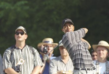 11 Jun 1997:  Tiger Woods hits his tee shot on the 14th hole during the 1997 U.S. Open at the Congressional Country Club in Bethesda, Maryland. Mandatory Credit: Doug Pensinger  /Allsport