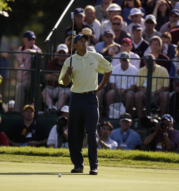 OLYMPIA FIELDS, IL - JUNE 14:  Tiger Woods misses a putt during the third round of the 2003 US Open on the North Course at the Olympia Fields Country Club on June 14, 2003 in Olympia Fields, Illinois. (Photo by Ross Kinnaird/Getty Images)