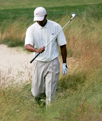 SOUTHAMPTON, NY - JUNE 19:  Tiger Woods reacts as after his second shot on the 16th hole landed in a bunker during the third round of the 104th U.S. Open June 19, 2004 at Shinnecock Hills Golf Club in Southampton, New York.  (Photo by Jamie Squire/Getty I