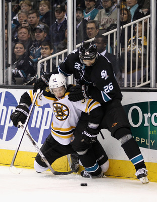 SAN JOSE, CA - MARCH 22:  Michal Handzus #26 of the San Jose Sharks and Jordan Caron #38 of the Boston Bruins go for the puck at HP Pavilion at San Jose on March 22, 2012 in San Jose, California.  (Photo by Ezra Shaw/Getty Images)