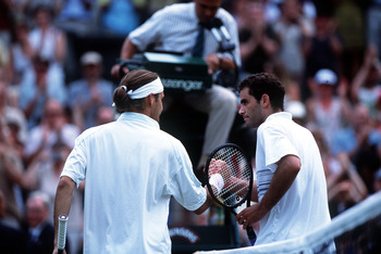 A changing of the guard - Sampras and Federer shake hands after Wimbledon 2001