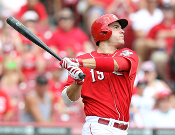 Joey Votto leads the NL in on-base and slugging percentage.