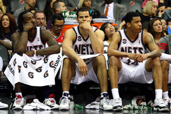 NEWARK, NJ - APRIL 23:  (L-R) Gerald Wallace #45, Kris Humphries #43 and Gerald Green #14 of the New Jersey Nets look on from the bench in the closing minutes of their 105-87 loss to the Philadelphia 76ers at Prudential Center on April 23, 2012 in Newark,