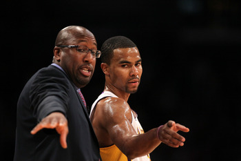 This is either Mike Brown and Ramon Sessions coaching, or dancing.