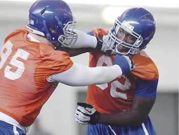 Demarcus Lawrence (right) practices in this Idaho Statesman photo.