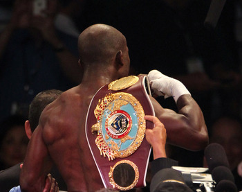 Timothy Bradley holding his new WBO welterweight belt