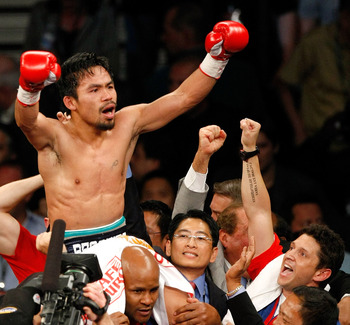 Manny Pacquiao celebrating an amazing victory