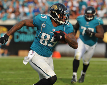 JACKSONVILLE, FL - JANUARY 01:  Tight end Marcedes Lewis #89  of the Jacksonville Jaguars runs upfield with a pass against the Indianapolis Colts January 1, 2012 at EverBank Field in Jacksonville, Florida.  (Photo by Al Messerschmidt/Getty Images)