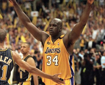 Shaq celebrates his first ring. ( Current Warriors coach Mark Jackson is in the background.)