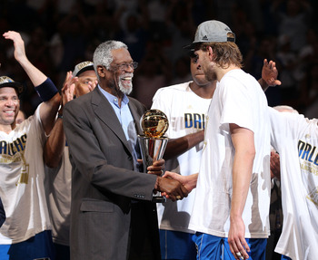 Dirk Nowitzki shakes the hand of NBA legend Bill Russell after winning the 2011 NBA Finals.