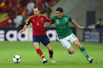 Iniesta handles the ball.