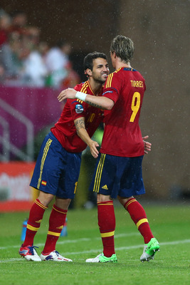 Funny looking picture of Cesc and Torres.