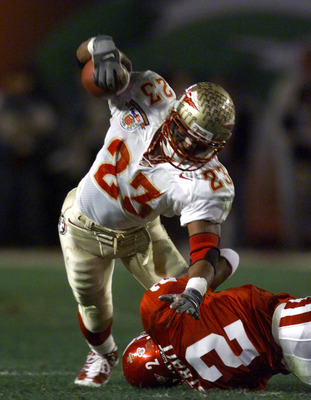 3 Jan 2001:  Travis Minor #23 of the Florida State Seminoles is brought down by Derrick Strait #2 of the Oklahoma Sooners during the Orange Bowl at Pro Player Stadium in Miami, Florida. DIGITAL IMAGE Mandatory Credit: Brian Bahr/ALLSPORT