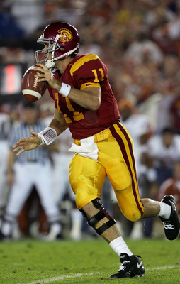 PASADENA, CA - JANUARY 04:  Quarterback Matt Leinart #11 of the USC Trojans looks for an open pass in the first half of the BCS National Championship Rose Bowl Game against the Texas Longhorns at the Rose Bowl on January 4, 2006 in Pasadena, California.