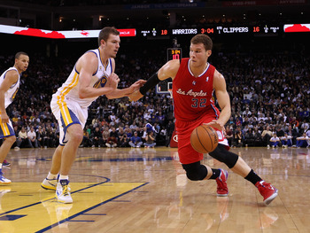 OAKLAND, CA - FEBRUARY 20:  Blake Griffin #32 of the Los Angeles Clippers drives on David Lee #10 of the Golden State Warriors at Oracle Arena on February 20, 2012 in Oakland, California.  NOTE TO USER: User expressly acknowledges and agrees that, by down