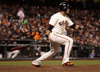SAN FRANCISCO, CA - MAY 29:  Melky Cabrera #53 of the San Francisco Giants hits a single in the eighth inning against the Arizona Diamondbacks at AT&T Park on May 29, 2012 in San Francisco, California. This was Cabrera's 50th hit in May that set a new San