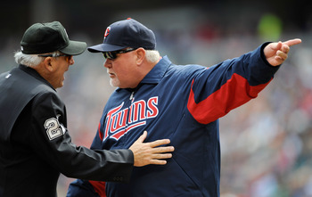 MINNEAPOLIS, MN - APRIL 29: Ron Gardenhire #35 of the Minnesota Twins speaks with home plate umpire Larry Vanover #27 after Danny Valencia #22 was called out on a play during the first inning against the Kansas City Royals on April 29, 2012 at Target Fiel