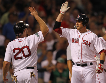 BOSTON, MA - MAY 30:  Will Middlebrooks #64 of the Boston Red Sox celebrates with Kevin Youkilis #20 after Middlebrooks hit a two-run home run against the Detroit Tigers in the fourth inning at Fenway Park May 30, 2012  in Boston, Massachusetts. (Photo by
