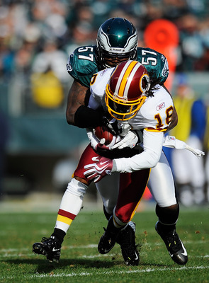 PHILADELPHIA, PA - JANUARY 01:   Keenan Clayton #57 of the Philadelphia Eagles tackles  Brandon Banks #16 of the Washington Redskins during a game at Lincoln Financial Field on January 1, 2012 in Philadelphia, Pennsylvania.  (Photo by Patrick McDermott/Ge